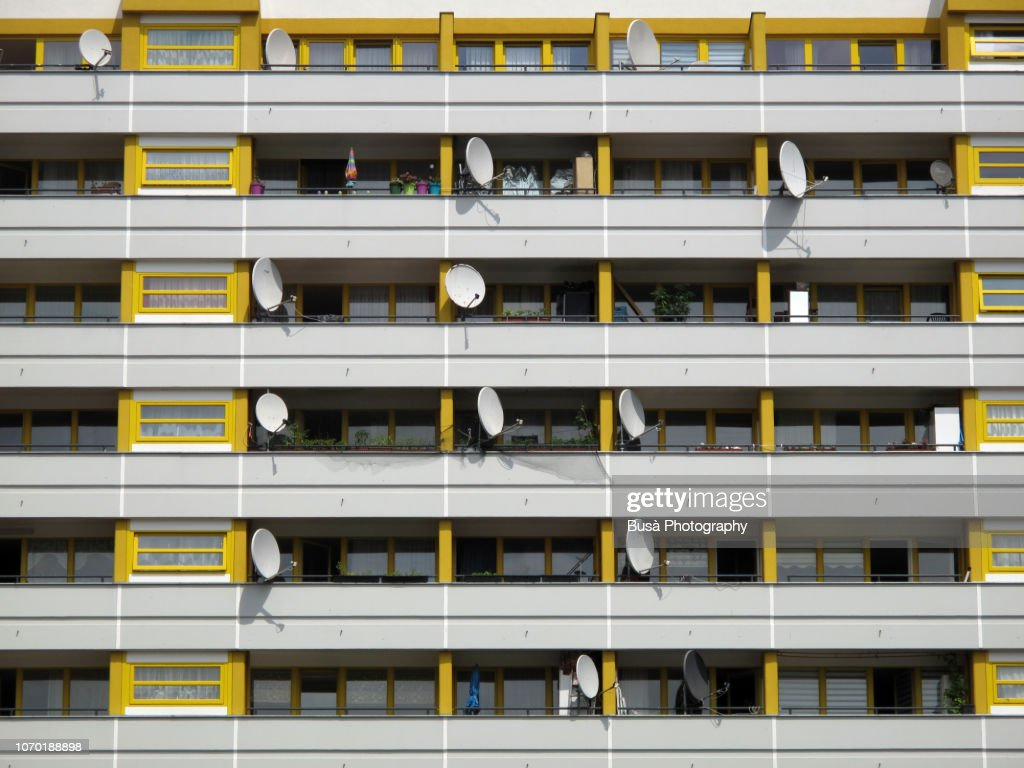 Satellite dishes on balconies of residential building in the district of Kreuzberg, Berlin : ストックフォト