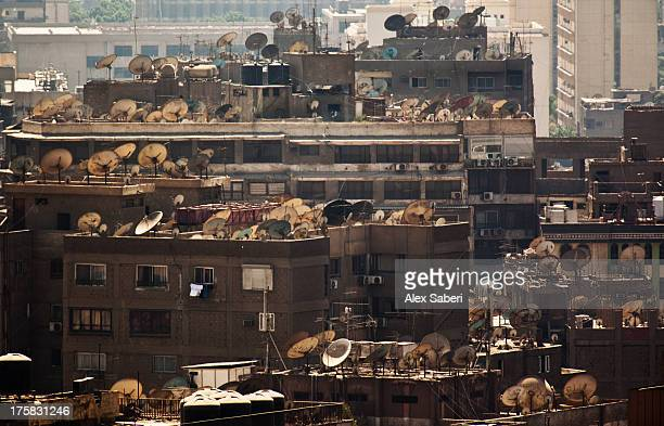 satellite dishes on cairo buildings. - alex saberi stock pictures, royalty-free photos & images