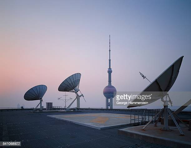 Satellite dishes with Pearl Tower in background