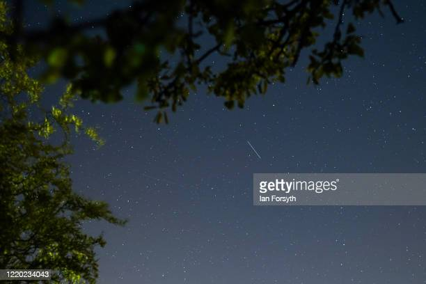 Satellite from a larger group of satellites called Starlink can be seen trailing across the night sky over Saltburn on April 21, 2020 in Saltburn By...