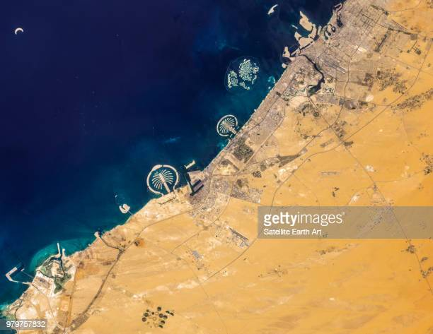 satellite image of dubai, united arab emirates - satellite view stock pictures, royalty-free photos & images