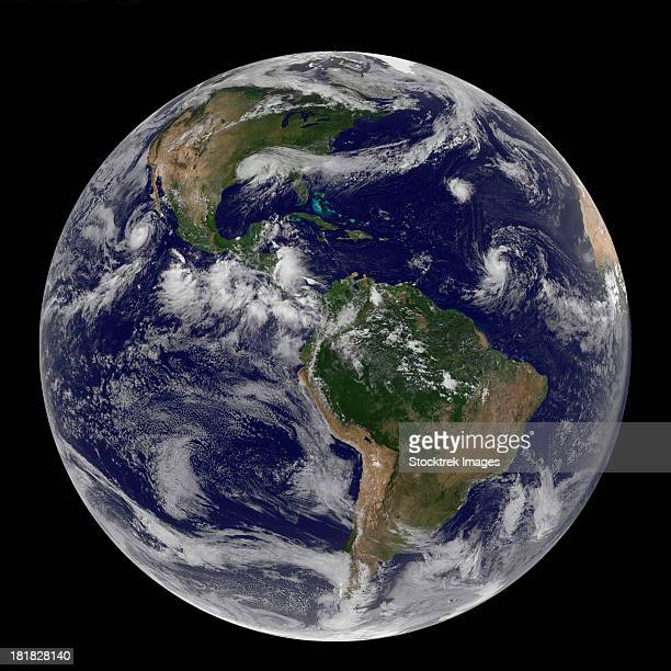 satellite image of earth and three tropical cyclones. - tropical storm isaac stock photos and pictures