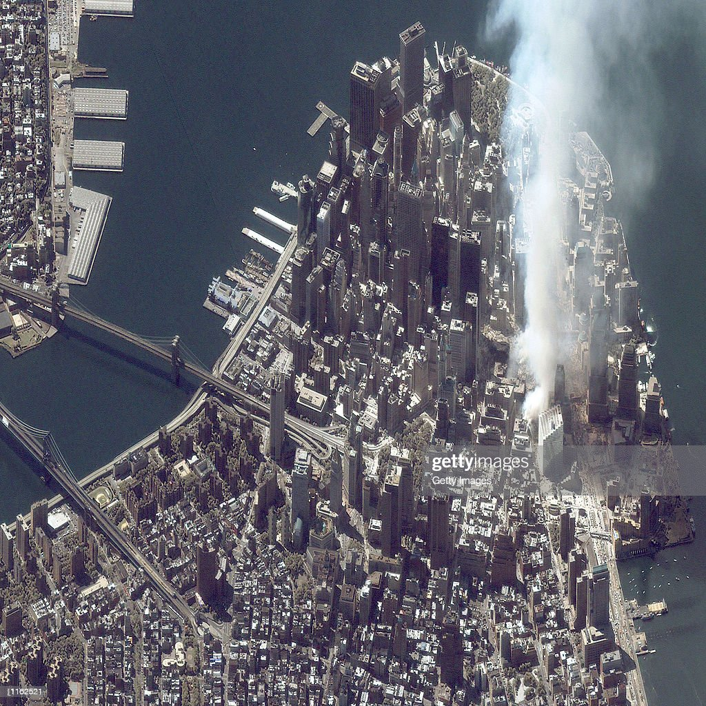 A satellite image of lower Manhattan shows smoke and ash rising from the site of the World Trade Center at 11:43 a.m. September 12, 2001 in New York City.