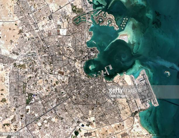 Satellite image of the city of Doha The PearlQatar Island located to the north Doha Port and Doha city in the centre with the Hamad International...
