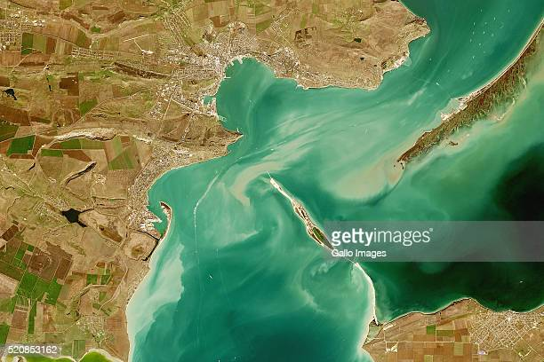 Satellite image of the Kerch Strait which links the Black Sea and the Sea of Azov on February 17 2016 Development of the Russian Kerch Strait Bridge...