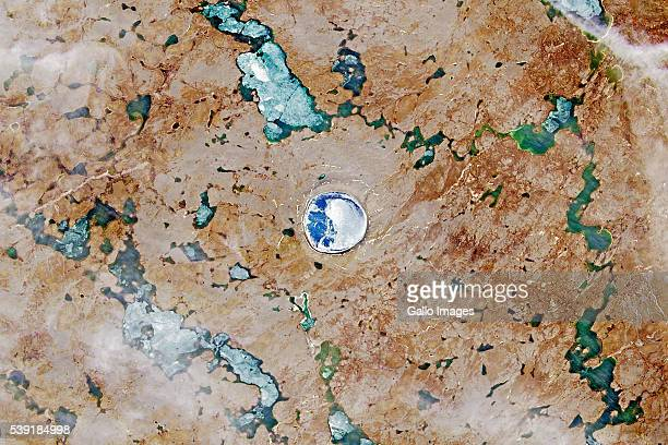 A satellite image of the Pingualuit asteroid impact crater in Quebec Canada on July 19 2015 Pingualuk Lake fills the centre of the crater and is over...