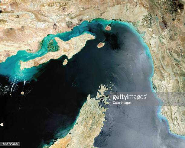 Satellite image of the Strait of Hormuz a strategic maritime choke point with Iran situated at the top with Qeshm Island and the United Arab Emirates...