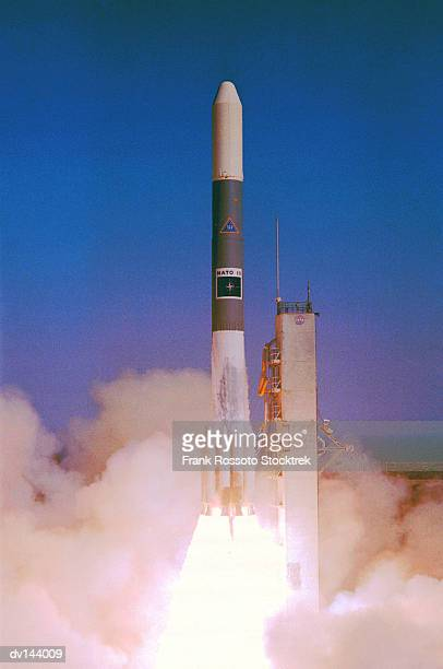 NATO satellite lifting off from launch pad