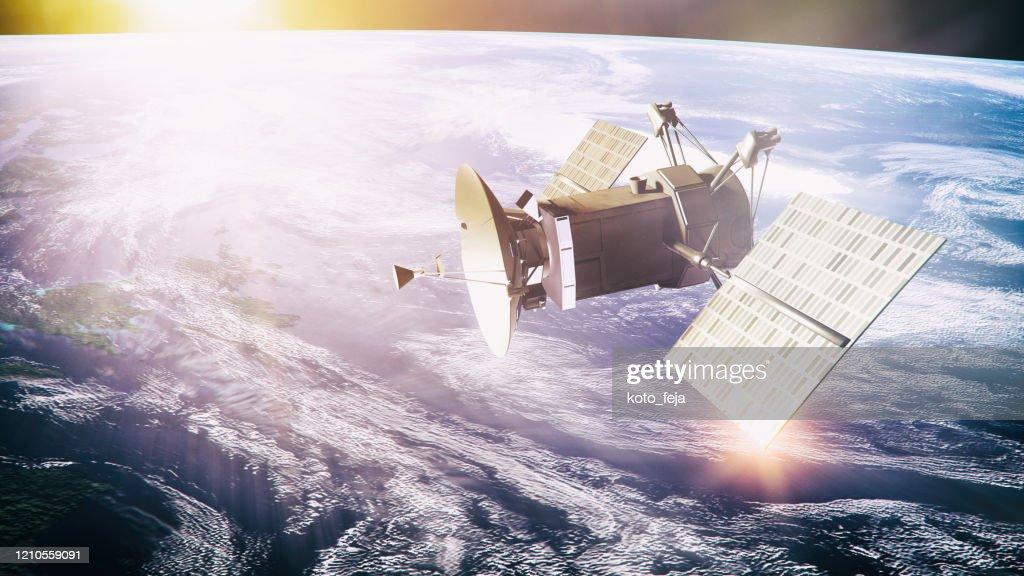 Satellite on planet background : Stock Photo