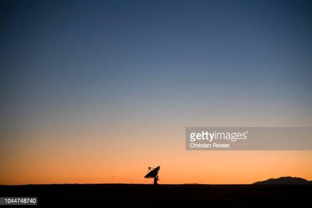 Satellite telescope at sundown in the desert, Arizona, USA