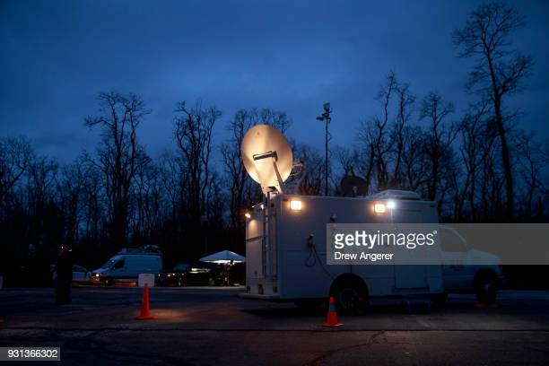 A satellite truck is parked before Conor Lamb Democratic congressional candidate for Pennsylvania's 18th district arrives at his polling station at...
