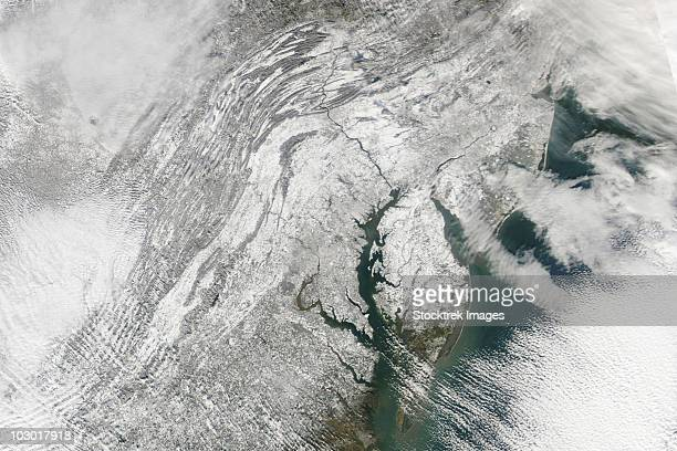 satellite view of a massive nor'easter snow storm over chesapeake bay. - potomac maryland stock pictures, royalty-free photos & images