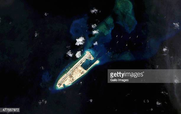 A satellite view of a South China Sea land reclamation project happening on the Fiery Cross Reef by the Chinese on June 14 2015 in Fiery Cross Reef...