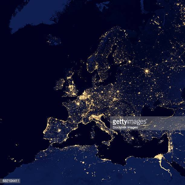 satellite view of city lights in several european and nordic cities. - europe stock-fotos und bilder