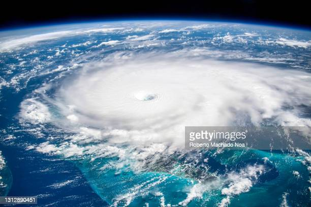 satellite view of hurricane dorian, year 2019 - hurricane stock pictures, royalty-free photos & images