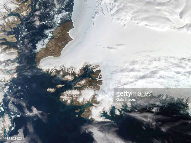A satellite view of Northwestern Greenland in the Arctic Circle and Nares Strait to the upper left with Baffin Bay to the bottom on August 12 2019 in...