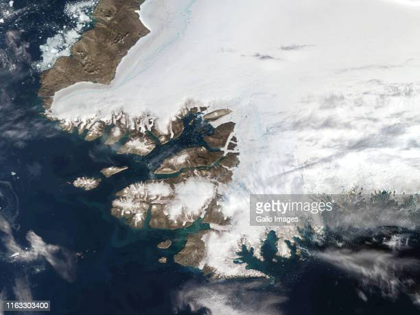 A satellite view of Northwestern Greenland in the Arctic Circle on August 12 2019 in Pituffik Greenland On the shores of Baffin Bay is the US Thule...