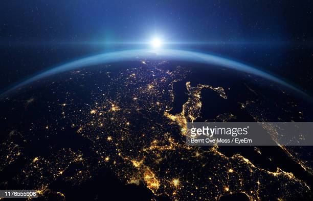 satellite view of planet at sunrise - pianeta terra foto e immagini stock