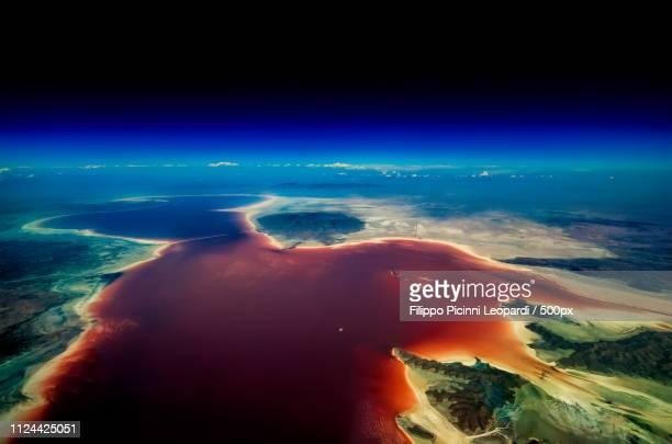 satellite view of red lake - lake urmia foto e immagini stock