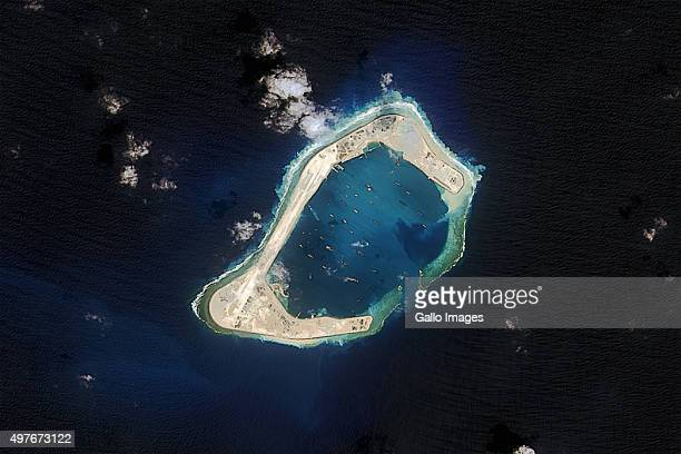 Satellite view of Subi Reef taken on October 20, 2015 in Fiery Cross Reef. Subi Reef is an artificial island under development by the Chinese within...