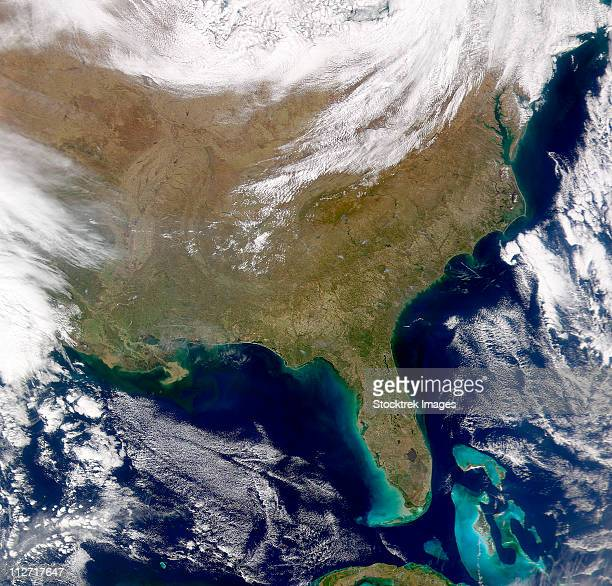 satellite view of the southeastern united states. smoke plumes are visible amongst the cloud-free skies. - gulf of mexico stock pictures, royalty-free photos & images