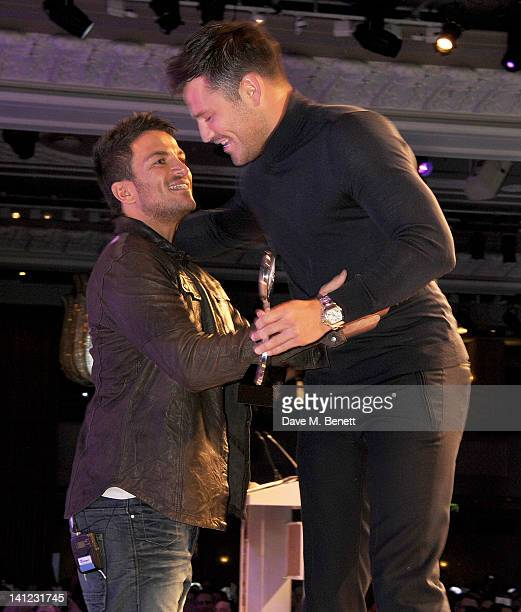 Satellite/Digital TV Personality award winner Peter Andre accepts his award from presenter Mark Wright at the TRIC Television and Radio Industries...