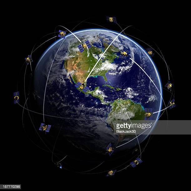 Satellites over world globe monitoring GPS localization