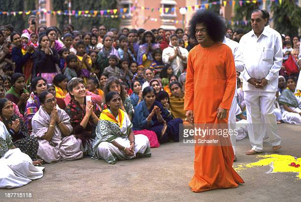 Sathya Sai Baba darshan at his temple in Puttaparthi, India. Each day thousands would gather around the temple in hopes for a glimpse of the holy...
