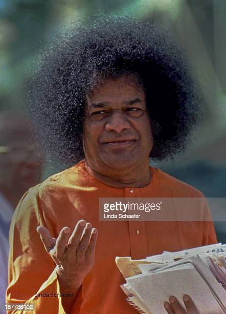 CONTENT] Sathya Sai Baba the famed guru from India who drew international crowds holds up his hand in his customary manner of raising awareness and...