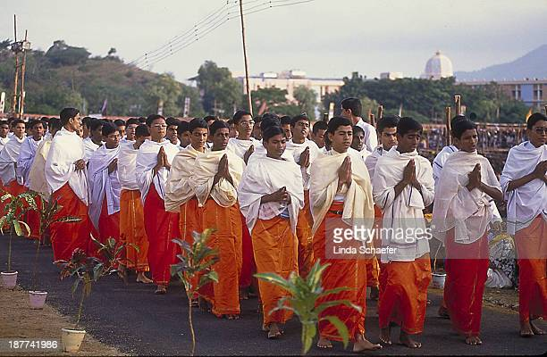CONTENT] Sathya Sai Baba's students leading the parade in honor of their beloved Guru's birthday These college students study in the center of...