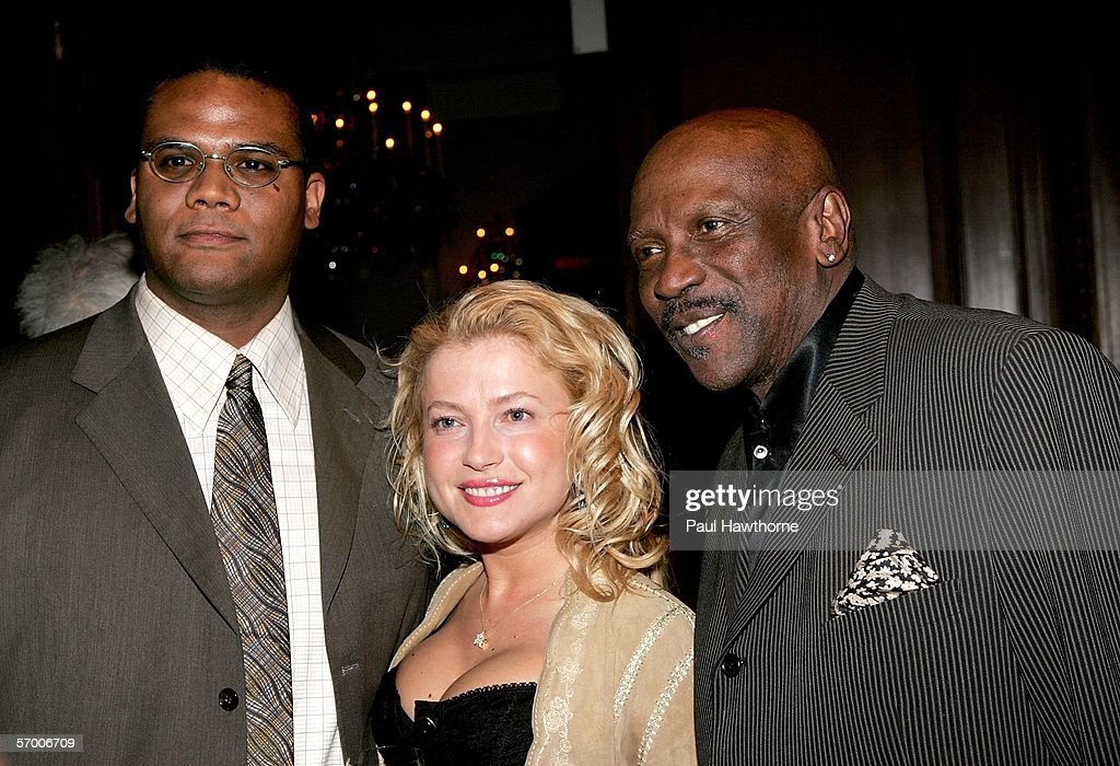 Satie Gossett, actress Anna Kulinova and actor Louis Gossett Jr. pose for a photo as they attend the Academy of Motion Picture Arts & Sciences New York Oscar Night Celebration at The St. Regis Hotel March 5, 2006 in New York City.