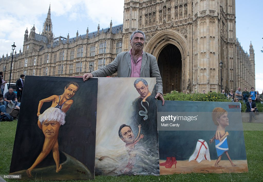 Satirical artist Kaya Mar poses for a photograph with Brexit-themed artwork depicting British Prime Minister David Cameron, former London Mayor Boris Johnson, Leader of the United Kingdom Independence Party (UKIP), Nigel Farage and Scotland's First Minister and Leader of the Scottish National Party (SNP), Nicola Sturgeon on June 24, 2016 in London, England. The results from the historic EU referendum has now been declared and the United Kingdom has voted to LEAVE the European Union.
