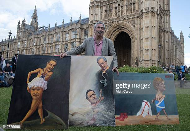 Satirical artist Kaya Mar poses for a photograph with Brexitthemed artwork depicting British Prime Minister David Cameron former London Mayor Boris...