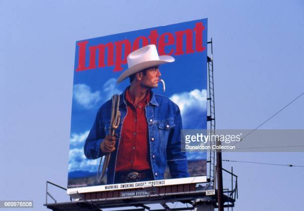 A satirical billboard of the iconic Marlboro Man in March 1993 reads Smoking Causes Impotence with a limp cigarette in Los Angeles California