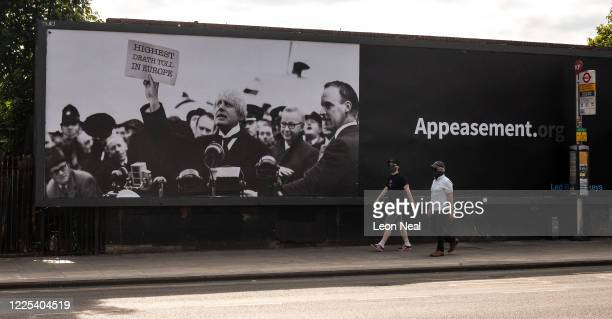 A satirical poster from the group Led By Donkeys depicting Boris Johnson as former British prime minister Neville Chamberlain is seen in Kentish Town...