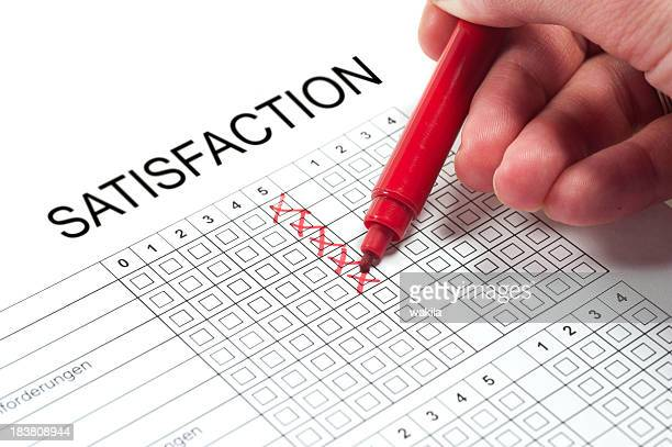 Satisfaction survey with red pen