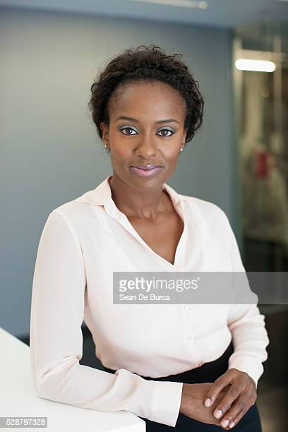 satisfied businesswoman - black blouse stock pictures, royalty-free photos & images