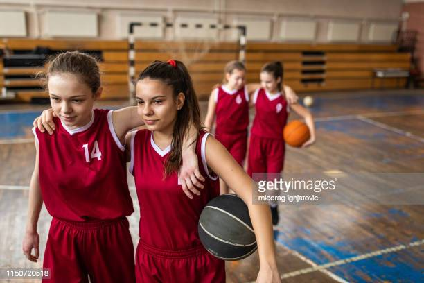 satisfied teenage girls leaving basketball field - team sport stock pictures, royalty-free photos & images