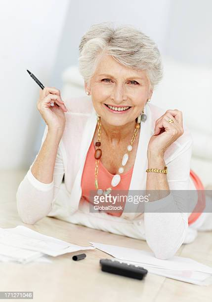 satisfied with her financial security! - seniors/budgets - security_(finance) stock pictures, royalty-free photos & images