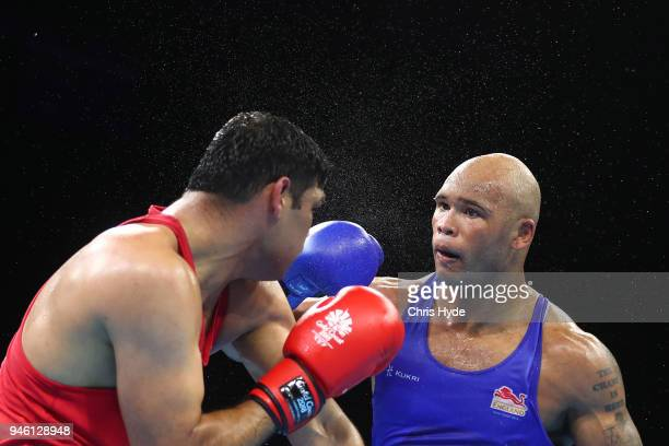 Satish Kumar of India and Frazer Clarke of England compete in the Men's 91kg Final Bout Boxing on day 10 of the Gold Coast 2018 Commonwealth Games at...