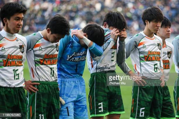 Sato Shibuki and Kanda Yusei of Aomori Yamada show their dejection after the 98th All Japan High School Soccer Tournament final match between Aomori...