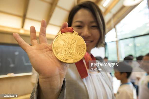 Satoko Mabuchi Softball 2008 Beijing Olympic Games gold medalist shows the gold medal during the project Sports Smile Classroom in Miyanomori...