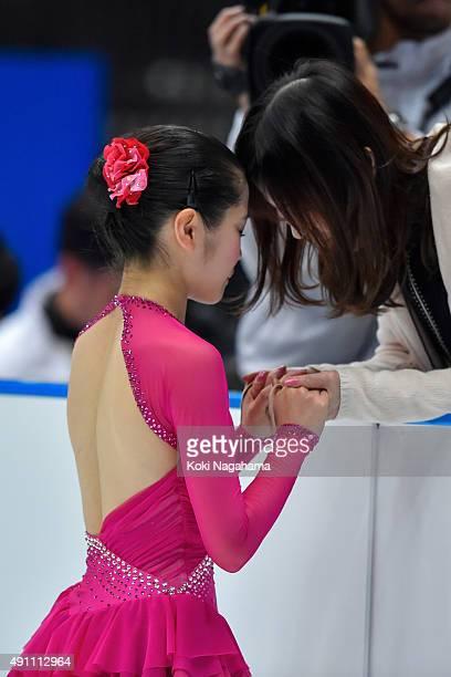 Satoko Miyahara of Japan has a moment with her coach in the Ladies Singles Free Skating during the Japan Open 2015 Figure Skating at Saitama Super...