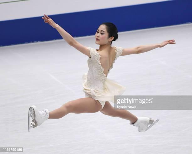 Satoko Miyahara of Japan performs her short program at the world figure skating championships at Saitama Super Arena near Tokyo on March 20 2019...