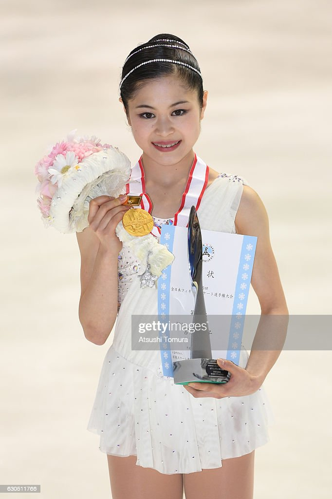 Satoko Miyahara (gold) of Japan poses with her gold medal after the Ladies free skating during the Japan Figure Skating Championships 2016 on December 25, 2016 in Kadoma, Japan.