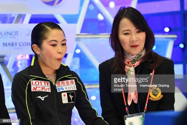 Satoko Miyahara of Japan reacts at the kiss and cry after the mladies short program during the ISU Junior Senior Grand Prix of Figure Skating Final...