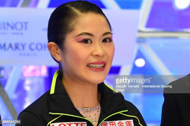 Satoko Miyahara of Japan smiles at the kiss and cry after the mladies short program during the ISU Junior Senior Grand Prix of Figure Skating Final...