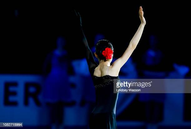 Satoko Miyahara of Japan who took gold waves to the crowd during the Ladies medal ceremony on day three of the 2018 ISU Grand Prix of Figure Skating...