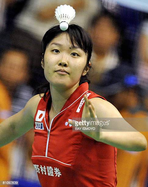 Satoko Suetsuna of Japan eyes the shuttlecock while playing against Lim Pek Siah of Malaysia during their woman's singles match at the Uber Cup...