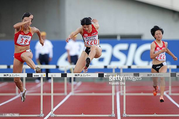 Satomi Kubokura of Japan competes with Yang Qi of China and Shiori Miki of Japan in the Women's 400m Hurdles final during the day three of the 19th...